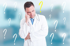 Professional pensive doctor thinking of an idea Stock Photography