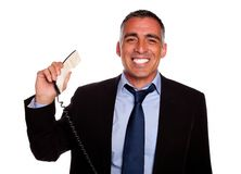 Professional person smiling with a phone Stock Images