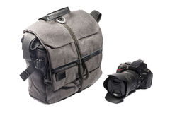 Professional photo bag and camera. Grey professional photo bag for camera and accessories Royalty Free Stock Image