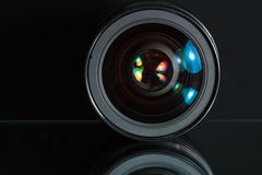 Professional photo lens in dark background Stock Photography