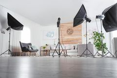 Professional photo studio equipment prepared for shooting living room. Interior royalty free stock images