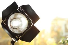 Professional photo studio lighting equipment on blurred background. Space for text royalty free stock image