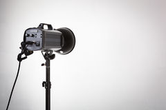 Professional photo studio strobe with reflector. Royalty Free Stock Photo