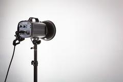 Professional photo studio strobe with reflector. Royalty Free Stock Photo