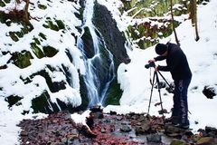 Professional photograph takes with camera on tripod  photo of winter waterfall. Royalty Free Stock Photos