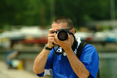 Professional Photographer. Photographer holding the camera,front view Stock Image