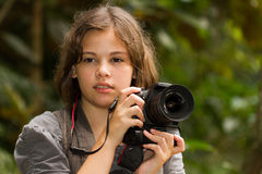 Professional Photographer. Beautiful girl holding a DSLR Stock Photo