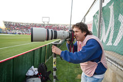Professional photographer in action in Copa Americ Royalty Free Stock Image