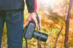 Professional photographer with camera in autumn. Vintage tone Stock Photography