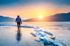 professional photographer with camera on frozen river in winter. South Korea in winter Royalty Free Stock Image