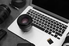 Professional photographer equipment and laptop. On table stock photography
