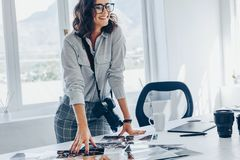 Professional photographer at her office royalty free stock photography