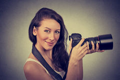 Professional photographer holding digital camera and smiling Royalty Free Stock Images