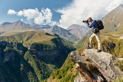 Professional photographer at mountain Stock Photo