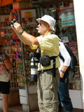 Professional photographer, old man, hanging large lens around hi. VENICE, ITALY - 6 JULY 2015 - Professional photographer, old man, hanging large lens around his Royalty Free Stock Photos
