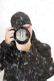 Professional photographer outdoor in winter Royalty Free Stock Photo