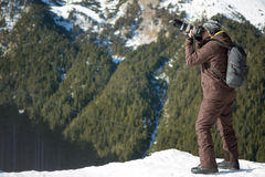 Professional photographer outdoor in winter Royalty Free Stock Photos