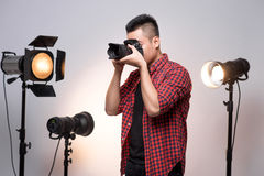 Professional photographer. Portrait of confident young man in sh Royalty Free Stock Images