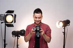 Professional photographer. Portrait of confident young man in sh Royalty Free Stock Photos