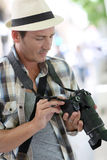 Professional photographer with reflex camera Stock Image