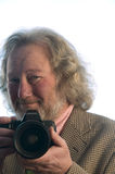 Professional photographer senior man long hair Royalty Free Stock Image