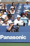 Professional photographer and spectators during US Open 2013 at Billie Jean King National Tennis Center Stock Images