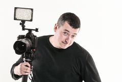 Professional photographer standing near the tripod.isolated on white.  royalty free stock images