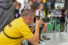 Nikon booth during CEE 2017 in Kiev, Ukraine. Professional photographer takes a pictureca on Nikon booth during CEE 2017, the largest electronics trade show of Royalty Free Stock Photography