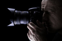 Professional photographer taking pictures with digital camera Royalty Free Stock Photography