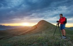 Professional photographer using a tripod, taking a photo Royalty Free Stock Photos