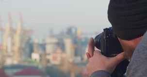 A Professional Photographer Or Videographer Removes A Seaport From A Mountain With A Tripod. Bearded Photographer Taking Pictures