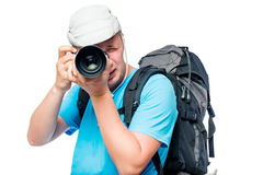 Professional photographer at work on the expedition. Is isolated Stock Photo