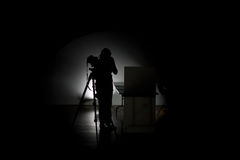 Professional photographer working in the studio. In low light royalty free stock photography