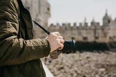 A professional photographer or a young male tourist photographes the sights in Lisbon in Portugal. Holds a camera. The. A professional photographer or a young Stock Images