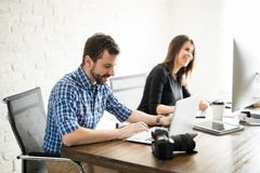 Professional photographers editing Royalty Free Stock Image