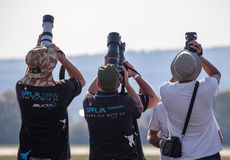 Professional photographers. SLIAC, SLOVAKIA - AUGUST 29: Profesional photographers at International air fest SIAF 2015 at airport Sliac on August 29, 2015 in stock photo