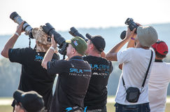 Professional photographers. SLIAC, SLOVAKIA - AUGUST 29: Profesional photographers at International air fest SIAF 2015 at airport Sliac on August 29, 2015 in stock image