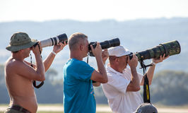 Professional photographers. SLIAC, SLOVAKIA - AUGUST 29: Profesional photographers at International air fest SIAF 2015 at airport Sliac on August 29, 2015 in stock photos