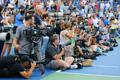 Professional photographers on tennis court during trophy presentation at the Arthur Ashe Stadium at US Open 2014 Royalty Free Stock Photo