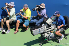 Professional photographers and TV camera man at US Open 2014 at Billie Jean King National Tennis Center Royalty Free Stock Photography