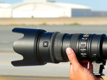 Professional Photography. A Professional Photographer taking shot with a telephoto lens Royalty Free Stock Images