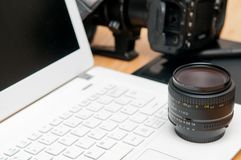 Professional photography editing equipment with camera and laptop. Photo gear for project background stock images
