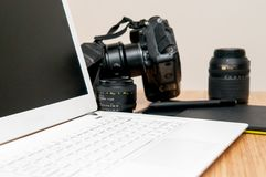Professional photography editing equipment with camera and laptop. Photo gear for project background stock photos