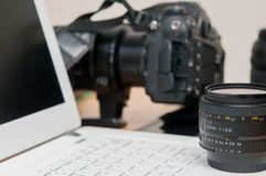 Professional photography editing equipment with camera and laptop. Photo gear for project background royalty free stock images