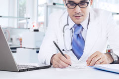 Professional physician makes medicine recipe Stock Photography