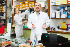 Professional physicians offering orthopaedic goods Royalty Free Stock Images