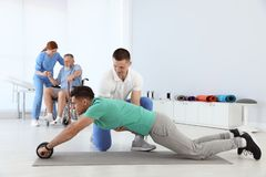 Professional physiotherapists working with patients stock image