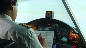 Professional pilot filling out papers before flight, getting ready to fly stock video footage