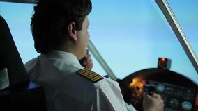 Professional pilot navigating passenger aircraft in dangerous turbulence zone. Stock footage stock footage