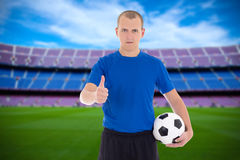 Professional player with soccer ball on the field Stock Photo